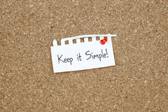 Keep it Simple Simplicity Concept. Keep it simple note on corkboard Stock Photos