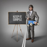 Keep it simple text on blackboard with businessman Royalty Free Stock Photography