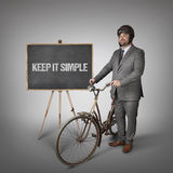 Keep it simple text on blackboard with businessman Stock Images