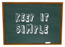 Keep it Simple Words Chalkboard Simplicity Advice Lesson. Keep it Simple words written or drawn on a chalkboard to illustrate the need to aim for simplicity to Royalty Free Stock Image