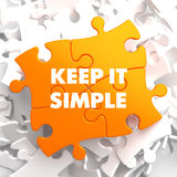Keep it Simple on Yellow Puzzle. Stock Photo