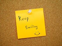 Keep smiling in post note Stock Photography