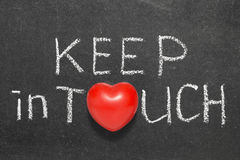 Keep in touch. Phrase handwritten on blackboard with heart symbol instead of O Royalty Free Stock Images