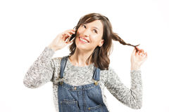 Keep in touch. Portrait of a happy young woman in casual clothes, speaking on cell phone. Connected anytime anywhere Royalty Free Stock Image