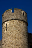 Keep tower. Castle keep tower close up against a deep blue sky. Round shaped Stock Photo