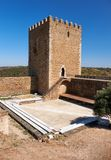 The keep tower of Mertola Castle. Mertola. Portugal. Keep tower of Mertola Castle with the adjoining fortress wall with battlements. Mertola. Portugal Stock Images