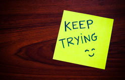 Keep trying on yellow sticky note Royalty Free Stock Photography