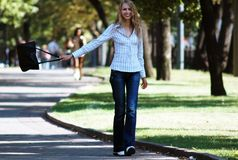 Keep walking. Girl walking in the park royalty free stock photography
