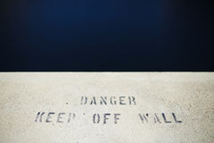 Keep of wall. Danger keep of wall inscription Stock Photo
