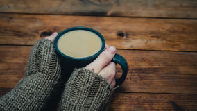 Woman get warming up with a cup of hot coffee Royalty Free Stock Images
