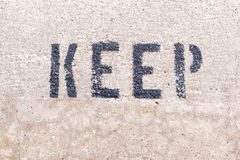 Keep word on the marble texture wall Stock Image