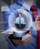 Keep your balance in the digital information overload. Businessman keeping cool with yoga Stock Image