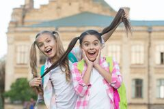 Free Keep Your Hair Long. Happy Children Hold Long Hair. School Girls In Pigtails. Trendy Long Hairstyle. Long Hair Growth Stock Images - 180706244