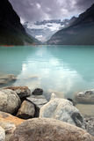 Keep Your Head In The Clouds. Lake Louise and view of the Victoria Glacier in Banff National Park, Alberta Royalty Free Stock Image