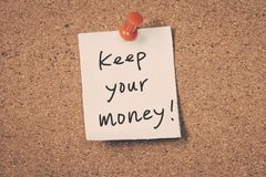 Keep your money. Reminder message on a cork board Royalty Free Stock Images