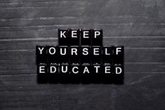 Keep yourself educated on wooden blocks. Education, Motivation and inspiration concept stock images