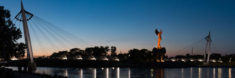 Keeper of the plains at night in Wichita Kansas. Keeper of the plains Indian chief sculpture and suspension bridge stands guard at the confluence of the Arkansas stock photos