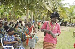 KEEPER OF SECRETS OF TRADITION. Guardians of the tradition of a lagoon village in the demonstration during a ceremony taditionnelle to explain to participants royalty free stock photography