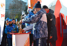 Keepers of the fire at the Olympic torch relay in Sochi Stock Photo