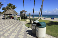 Keeping the Beach Clean. DEERFIELD BEACH, FLORIDA - FEBRUARY 1: Garbage and recycling cans, along with a recycling program that started in 1988, helps keep a Royalty Free Stock Photo