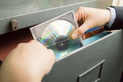 Keeping a cd file in cabinet Royalty Free Stock Image