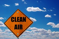 Keeping it clean. Road sign with a clear blue sky Royalty Free Stock Images