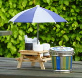Condiment set under umbrella on outdoor cafe table Royalty Free Stock Image