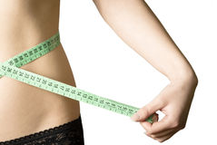 Keeping a diet and fitness rutine. Measuring tape around a waist, woman Stock Images