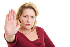 Keeping the distance. Woman reaching out with the palm of her hand Stock Photography