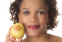 Keeping doctor away. Lipsitck mark on apple to indicate love to healthy food Stock Image