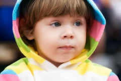 Keeping an Eye On Mammy. Cute 2 year old girl in casual hood jacket looking after her mother stock image