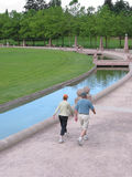 Keeping Fit. A middle-aged couple walks in a city park to keep fit Stock Photo