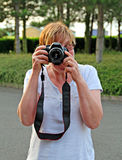 Keeping focused!. Photo of a photography student having fun learning about her new digital camera Stock Photography