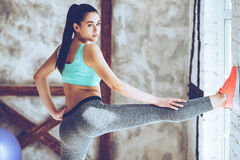 Keeping her legs in great shape. Royalty Free Stock Photo