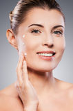 Keeping her skin young and smooth. Royalty Free Stock Images