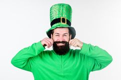 Keeping his moustache in shape. Hipster in leprechaun hat and costume. Bearded man celebrating saint patricks day. Happy. Saint patricks day. Irish man with stock images