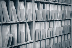 Keeping records. Keeping paper records on the shelves Royalty Free Stock Images