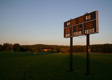 Keeping Score. A local scoreboard in some really beautiful light Stock Photography