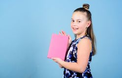 Keeping secrets here. design expert. pr-specialist. small girl with pink note book. school child with notepad. workbooks. For writing. school diaries for making stock photos