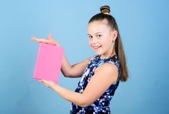 Keeping secrets here. Keeping her secrets in diary. Child cute girl hold notepad or diary blue background. Childhood. Memories. Note secrets down in cute girly stock photos