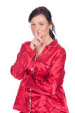 Keeping silent young woman in red pajamas Royalty Free Stock Photo