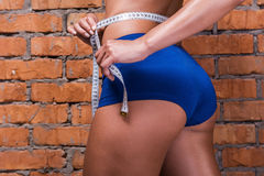 Keeping track on her weight loss. Royalty Free Stock Images
