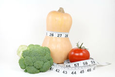 Keeping Trim with Vegetables. A diet with vegetables contributes to a trim figure stock images