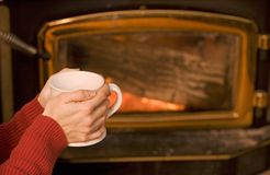 Keeping Warm by the Fireplace Stock Photography