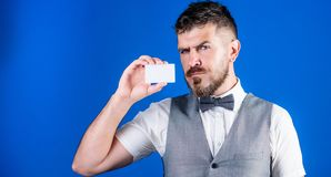 Keeping your company top of mind. Businessman with bank card. Bearded man holding business card. Hipster with credit. Card. Empty card for your contact royalty free stock image