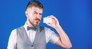 Keeping your company top of mind. Businessman with bank card. Bearded man holding business card. Hipster with credit. Card. Empty card for your contact stock photos