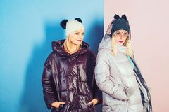 Keeps warm and looks good. women wear warm winter coats. Pretty women in fashionable puffers. Fashion models in stock photography