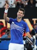 14 keer de Kampioen Novak Djokovic van Grand Slam van Servië viert overwinning na zijn halve finalegelijke bij het Australian Ope stock fotografie