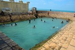 Keerimalai fresh water spring tank by ocean water Jaffna Sri Lanka. Jaffna, Sri Lanka - February 19, 2017: A bathing tank full of boys in Keerimalai, Jaffna Royalty Free Stock Image