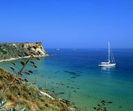 Kefalonia sailing. A sailboat off the coast of Kefalonia, Greece. Taken from high on a cliff royalty free stock photography